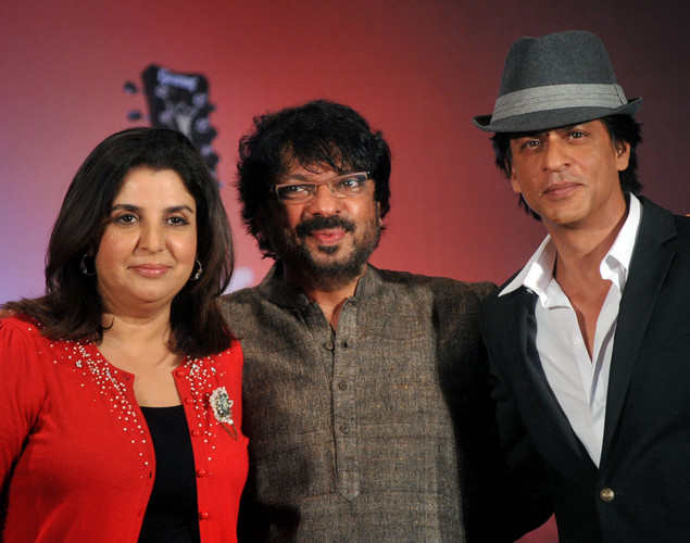Bollywood film actors Shahrukh Khan (R) and Farah Khan pose with producer Sanjay Bhansali (C) during the third teaser poster and music launch of the forthcoming Hindi film 'Shirin Farhad Ki Toh Nikal Padi' directed by Bela Bhansali Sehgal in Mumbai.