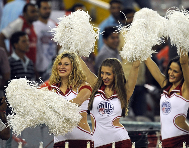 Kings XI Punjab cheerleaders arrive prior to the IPL Twenty20 cricket match between Kings XI Punjab and Pune Warriors at PCA Stadium.