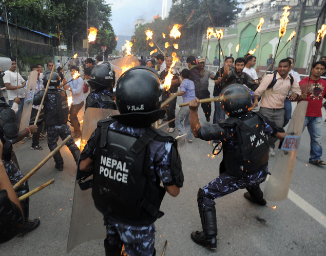 Nepalese riot police clash with Youth Force Wing activists of the Communist Party of Nepal (UML) during a protest demanding the resignation of Prime Minister Baburam Bhattarai in Kathmandu.