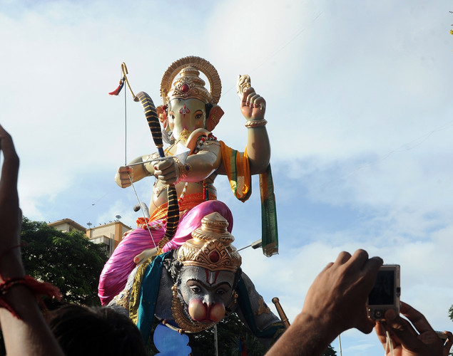 Indian Hindus carry a huge idol of the elephant-headed Hindu god Lord Ganesha through the busy streets of Mumbai.