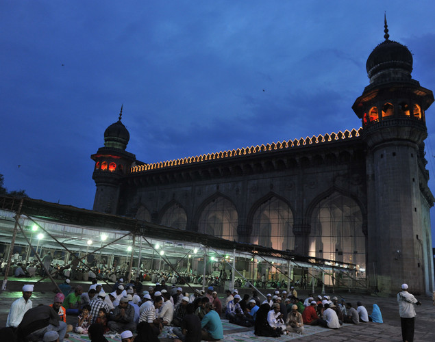 Indian Muslims break their fast on the first day of the month of Ramadan at Mecca Masjid in Hyderabad.