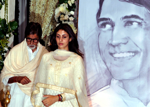 Amitabh Bachchan (L) with daughter Shweta Bachchan attend a prayer function in memory of late actor Rajesh Khanna in Mumbai on July 21, 2012.