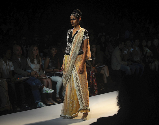 A model showcases a creation by designer Krishna Mehta on the third day of Lakme Fashion Week (LFW) winter/festive 2012 in Mumbai on August 5, 2012.