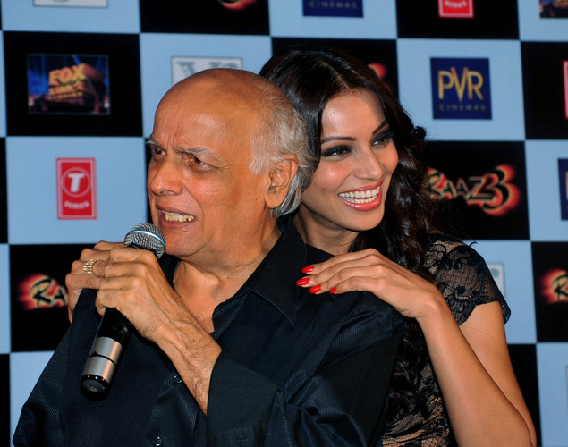 Bollywood film actors Bipasha Basu (R) poses with producer Mahesh Bhatt during the launch of the first trailer of upcoming Hindi horror thriller film 'Raaz 3' directed by Vikram Bhatt in Mumbai.