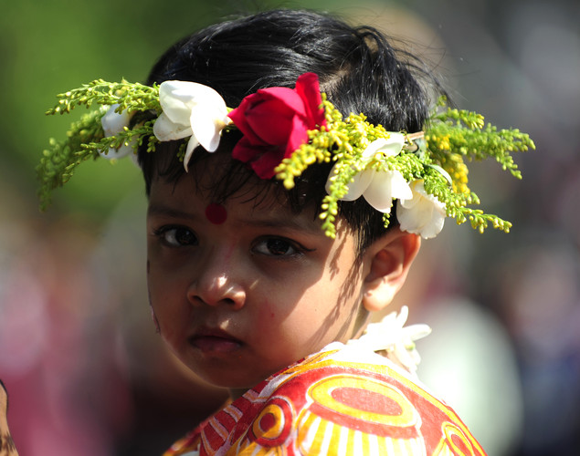 "Bangladeshi child attends a rally in celebration of the Bengali New Year or ""Pohela Boishakh"" in Dhaka."