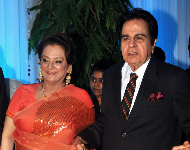 Bollywood film actor Dilip Kumar (R) and his wife Saira Banu pose during the wedding reception ceremony of film actress Esha Deol and husband Bharat Takhtani in Mumbai.