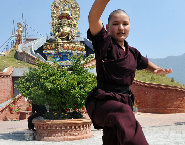 A Buddhist nun practices Kung-fu at the Amitabha Drukpa Nunnery on the outskirts of Kathmandu