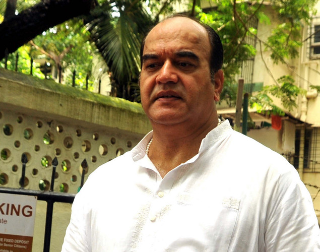 Bollywood actor Surendra Pal attends the cremation ceremony of late Indian actor Dara Singh in Mumbai.