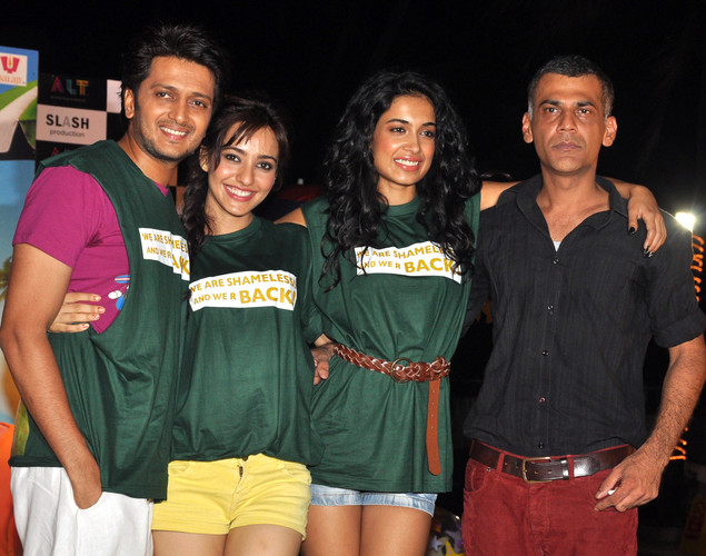 "Ritesh Deshmukh (L) poses with Neha Sharma (2L) and Sarah Jane Dias (2R) and director Sachin Yardi (R) during a promotional event for the forthcoming Hindi film ""Kyaa Super Kool Hai Hum"" directed by Sachin Yardi in Mumbai."