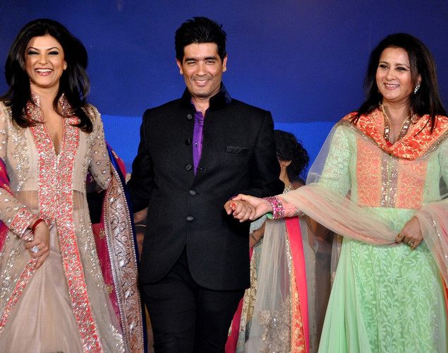 "Sushmita Sen (L) and Poonam Dhillon (R) displays creations by designer Manish Malhotra (C) for a public awareness campaign ""Save and Empower the Girl Child"" in Mumbai."
