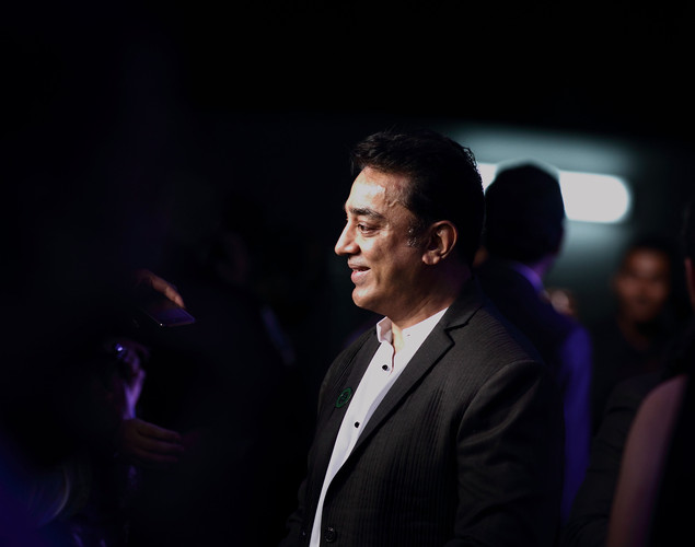 Indian actor Kamal Hassan speaks to the media at the IIFA green carpet event at the 2012 International India Film Academy Awards at the Singapore Indoor Stadium.