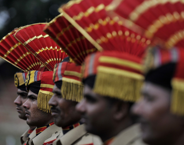 Indian Central Reserve Police Force (CRPF) stand at attention during celebrations marking India's Independence Day at The Bakshi Stadium in Srinagar on August 15, 2012.