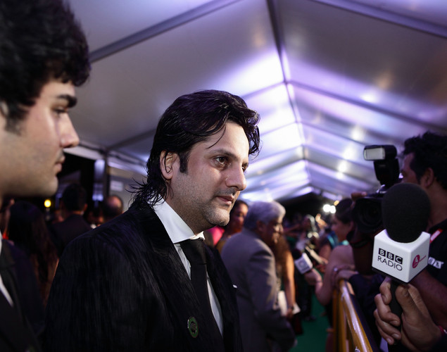 Indian actor Fardeen Khan(C) speaks to the media at the IIFA green carpet event at the 2012 International India Film Academy Awards at the Singapore Indoor Stadium.