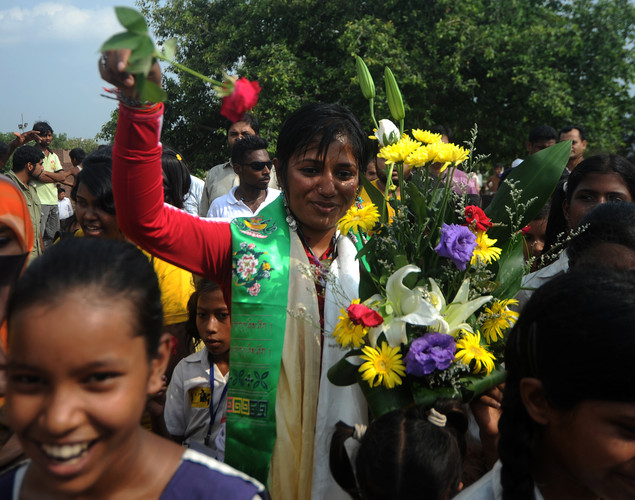 Bangladeshi mountaineer Wasfia Nazreen (C) arrives at the Martyred for Intellectuals Memorial in Dhaka.