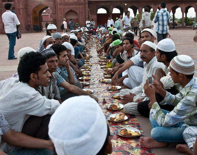 Indian Muslims wait to break their fast during sunset on the first day of the fasting month of Ramadan at the Jama Masjid Mosque in New Delhi.