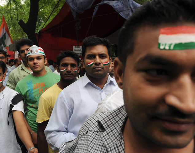 Supporters of anti-corruption activist Anna Hazare wait in a queue during a rally where Hazare began his hunger strike in New Delhi.