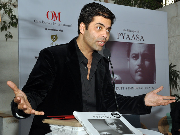Karan Johar attends the book launch of 'The Dialogue of Pyaasa' -a classic Indian movie directed in 1957 by Guru Dutt- in Mumbai on February 2, 2011. AFP PHOTO/STR
