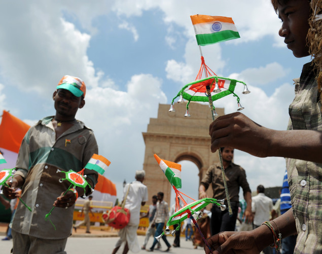 Street vendors sell adornments with the Indian flag at the India Gate monument in New Delhi on August 15, 2012.