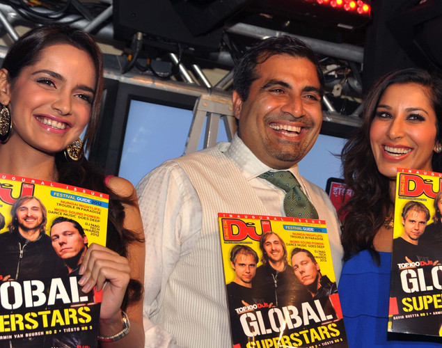 Bollywood actresses Shazahn Padamsee (L) and Sophie Choudhry (R) pose with Shailendra Singh during the DJ Mag launch event in Mumbai.