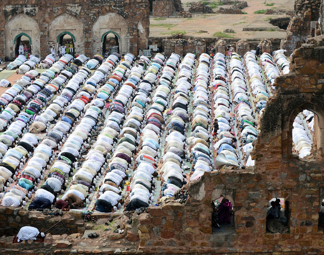 Indian Muslims offer Eid al-Fitr prayers amongst the ruins of the Feroz Shah Kotla fort and mosque in New Delhi.