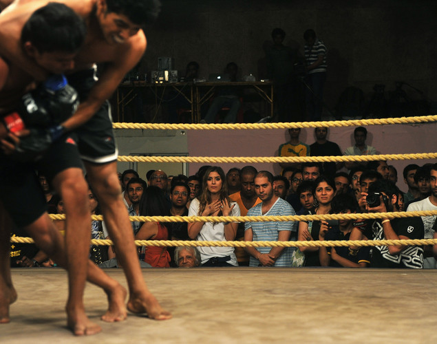 Spectators watch a Mixed Martial Arts (MMA) bout at the FCC (Full Contact Championship) 6 fight night in Mumbai.