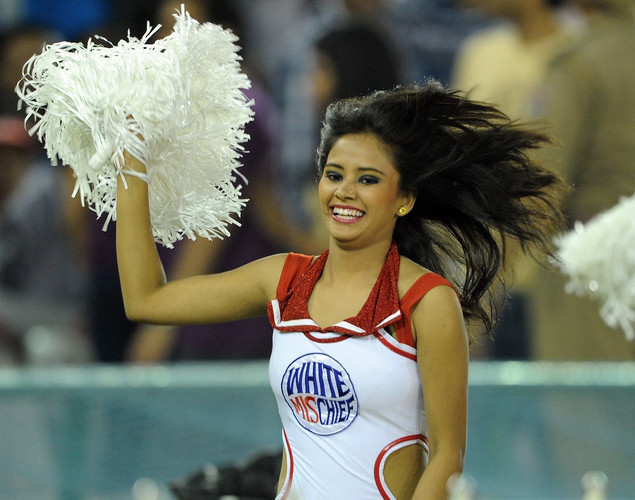 A Kings XI Punjab cheerleader performs prior to the IPL Twenty20 cricket match between Kings XI Punjab and Kolkata Knight Riders at PCA Stadium.