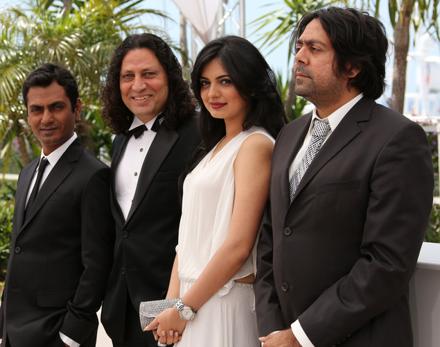 Nawazuddin Siddiqui (L), Niharika Singh (C) and Anil George and Indian director Ashim Ahluwalia pose during the photocall of 'Miss Lovely' presented in the Un Certain Regard selection at the 65th Cannes film festival.