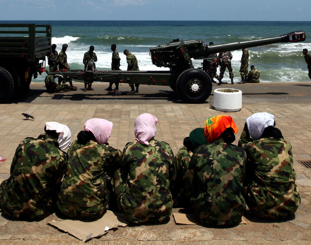 Female Sri Lankan military officers rest during military parade rehearsals in preparation for the celebration of the third anniversary of the civil war and the defeat of the separatist Tamil Tiger rebels.