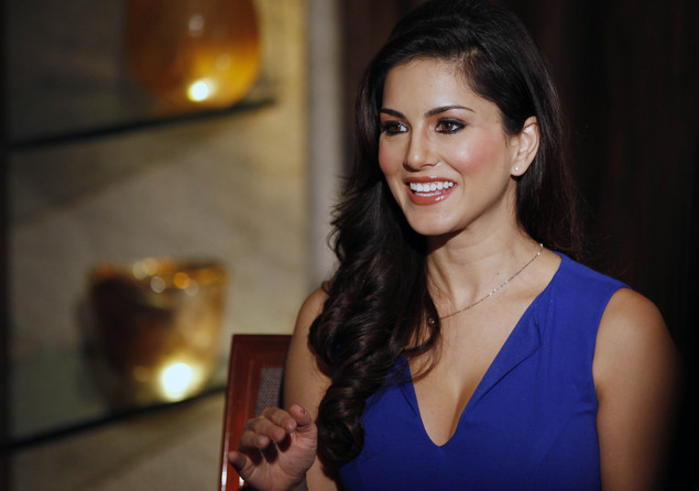 "In this Sunday, July 29, 2012 photo, hard-core porn actress Sunny Leone, who stars in Bollywood film ""Jism 2"" speaks to the media in Mumbai, India."