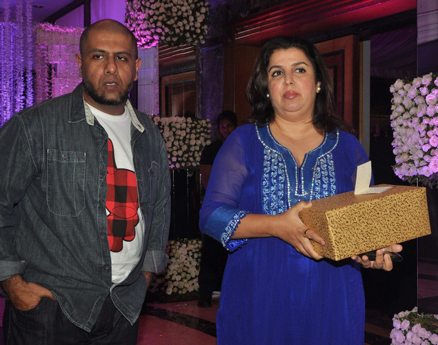 Bollywood music director Vishal (L) and choreographer Farah Khan attend the wedding reception of playback singer Sunidhi Chauhan and musician Hitesh Sonik.