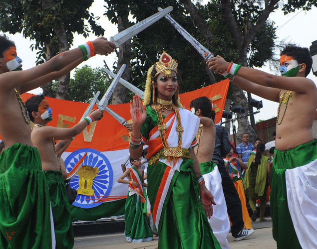 Indian school children perform during celebrations on the eve of Independence Day at India-Pakistan Wagah Border Post on August on 14, 2012.
