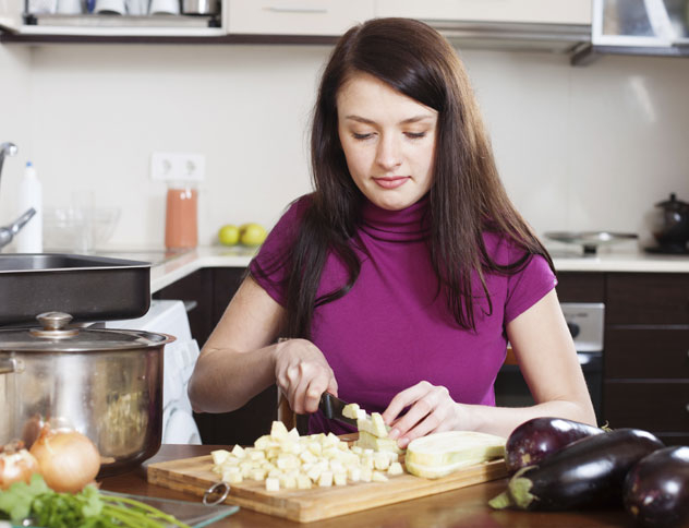 Woman Dicing Eggplant